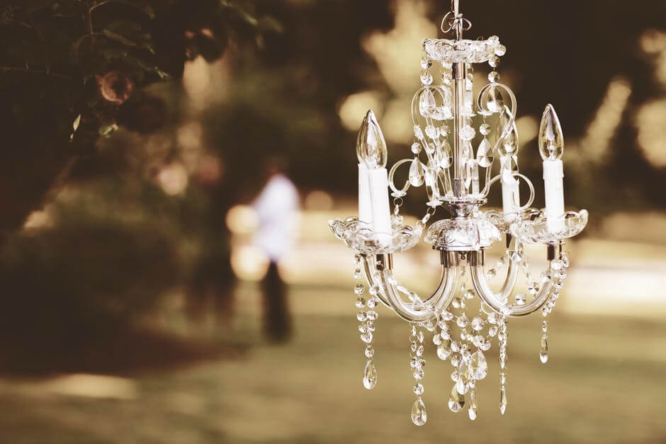 how to light outdoor space chandelier structure architectural feature gazebo