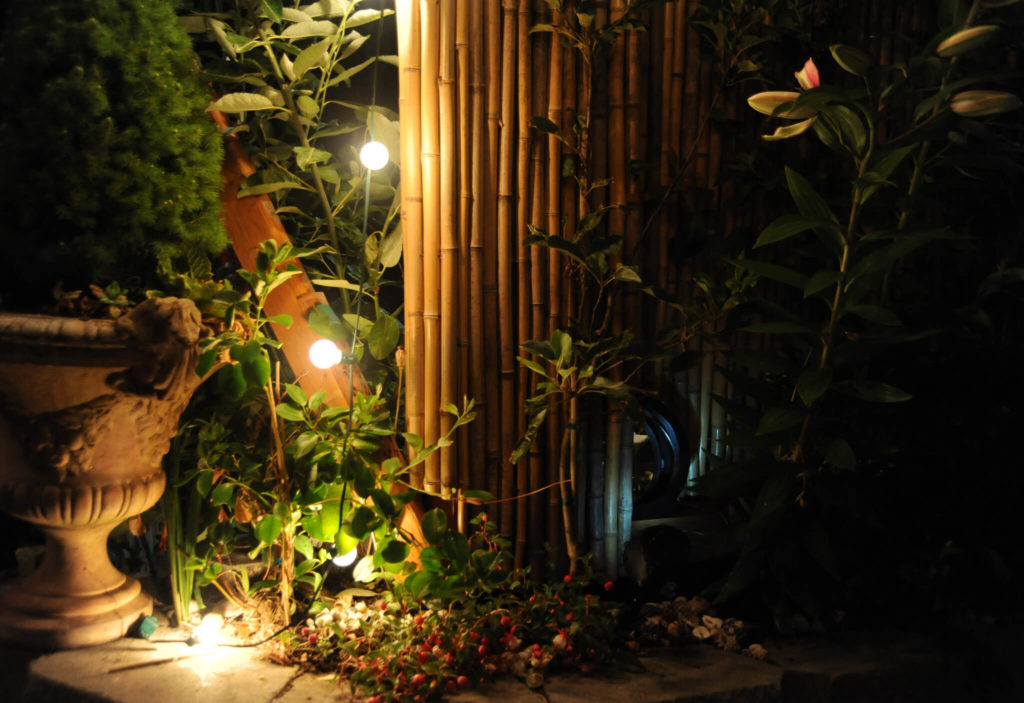 how to light outdoor space garden water feature fountain